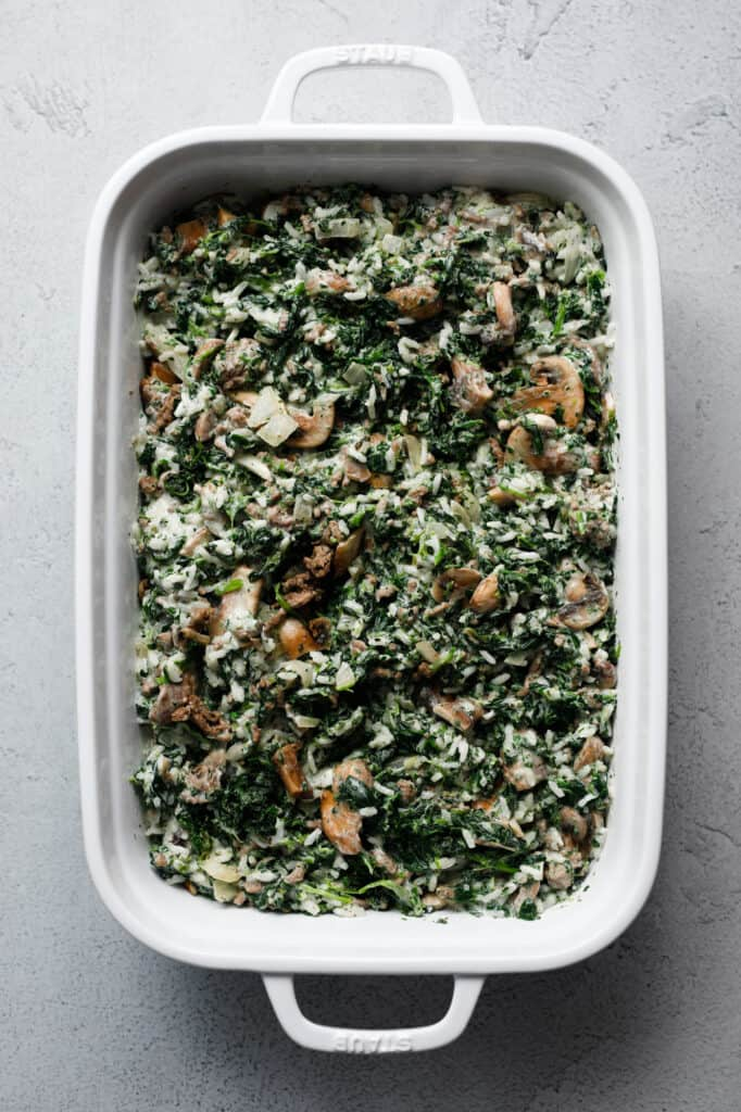 Overhead image of a cast iron dish filled with a spinach, beef and mushroom mixture.