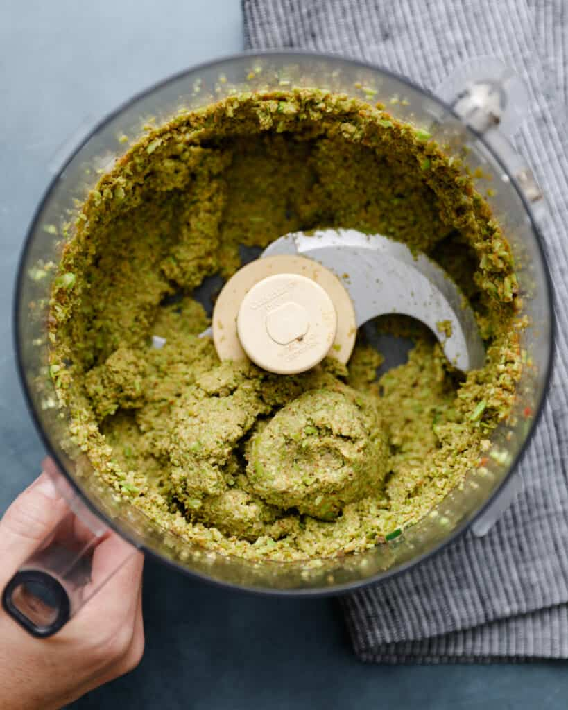 overhead shot of a food processor with an edamame and chia seed mixture