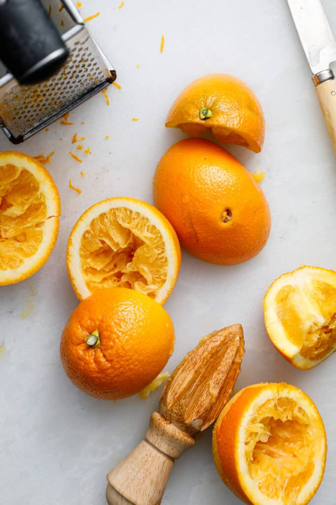 overhead shot of oranges with a grater to be added to the recipe