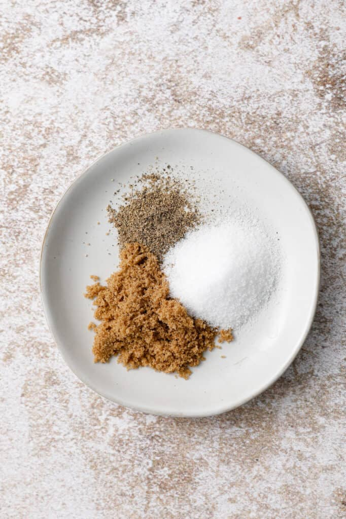 overhead image of a dish with brown sugar, salt and pepper