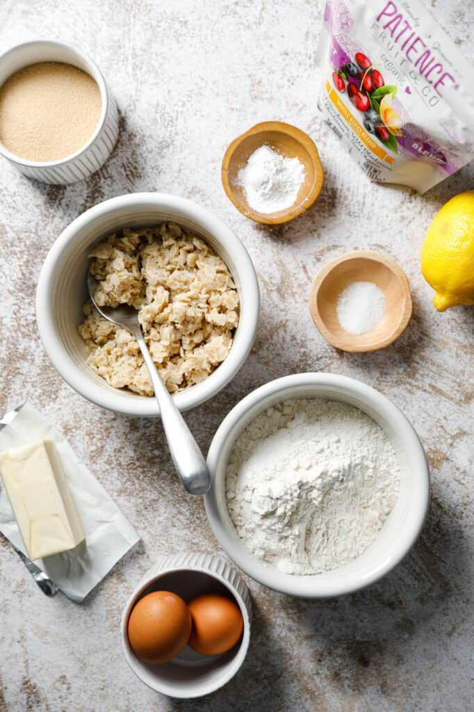 The ingredients needed to make cookies with leftover oatmeal, flour, eggs, sugar, butter and dried fruit