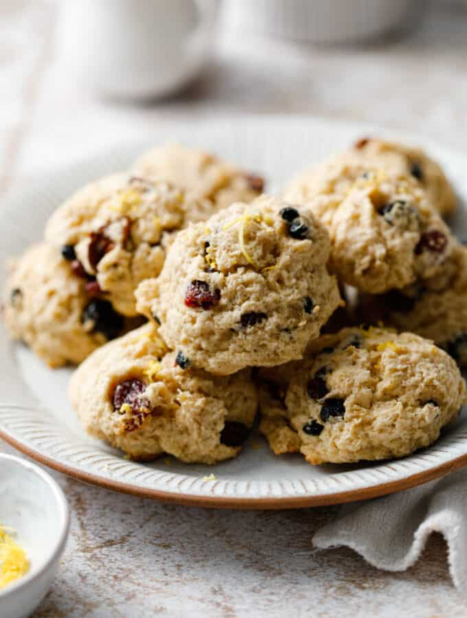 A plate of leftover oatmeal cookies with dried fruit pieces