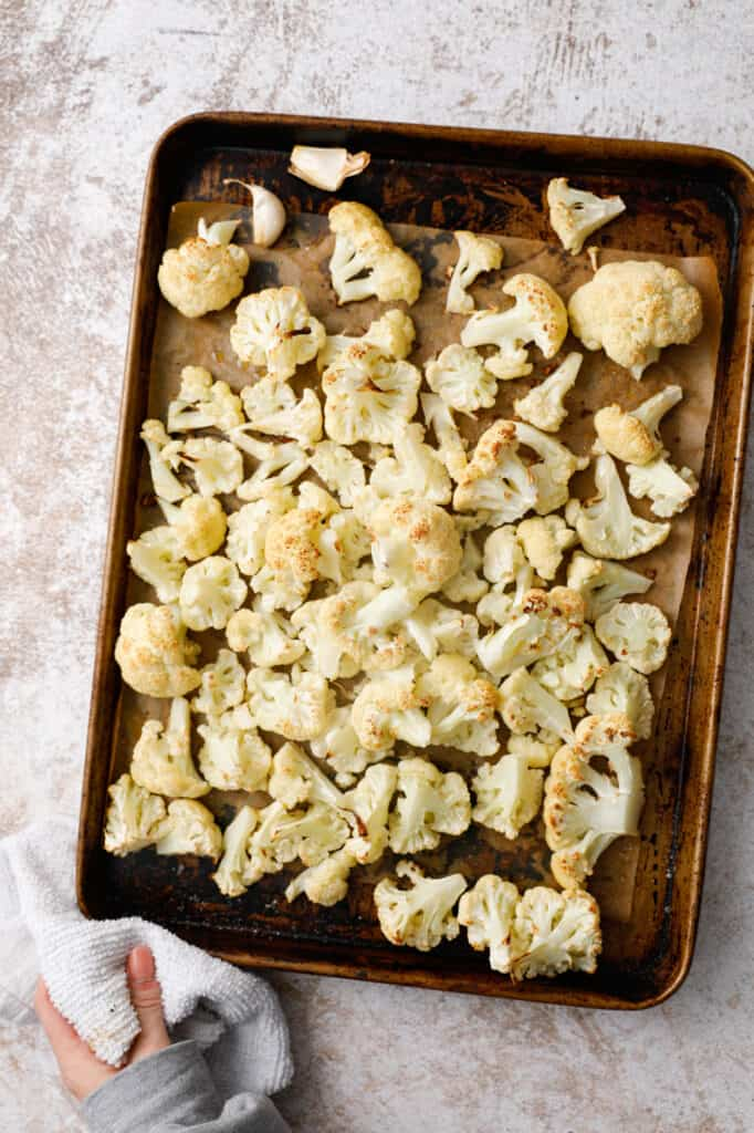 overhead view of a pan of roasted cauliflower from the oven