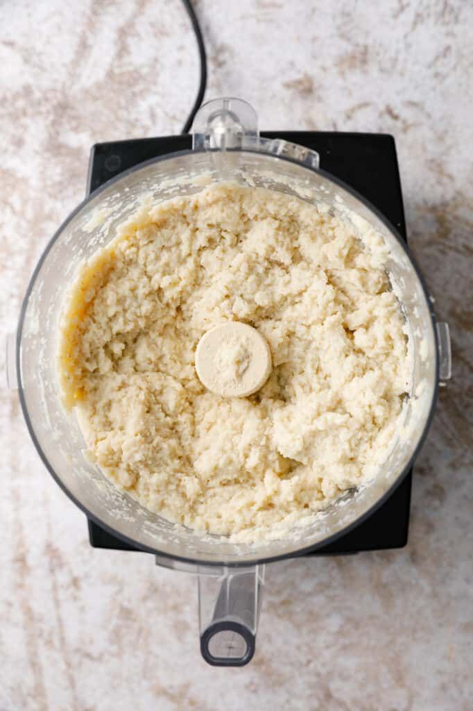 overhead view of a food processor with cauliflower mash inside