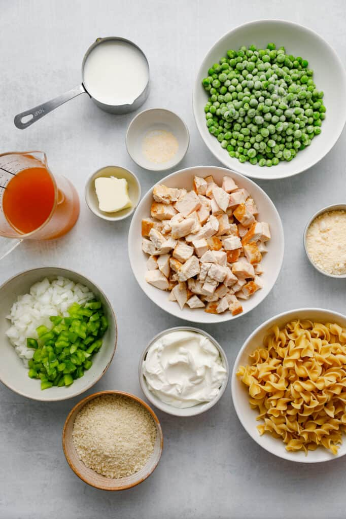 Ingredients for Creamy Chicken Noodle Casserole including frozen peas, egg noodles and sour cream