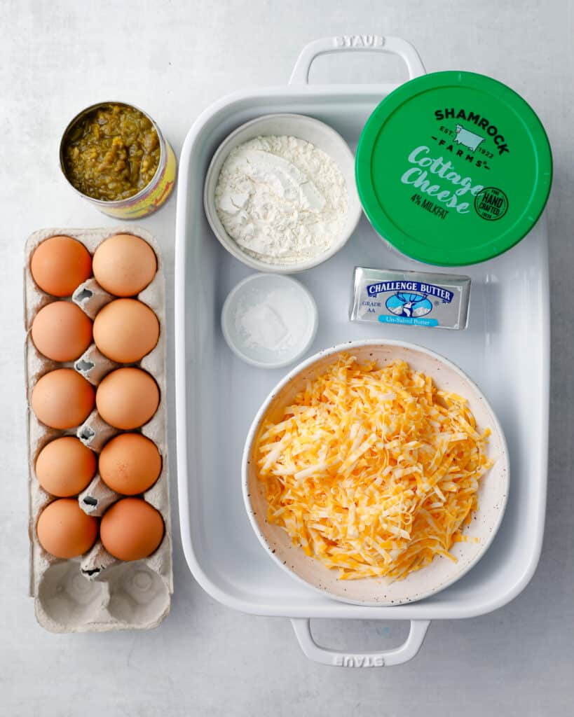 the ingredients to make green chili egg casserole - an easy overnight breakfast casserole - eggs, green chilis, flour, baking powder, butter, cottage cheese, colby jack or cheddar cheese
