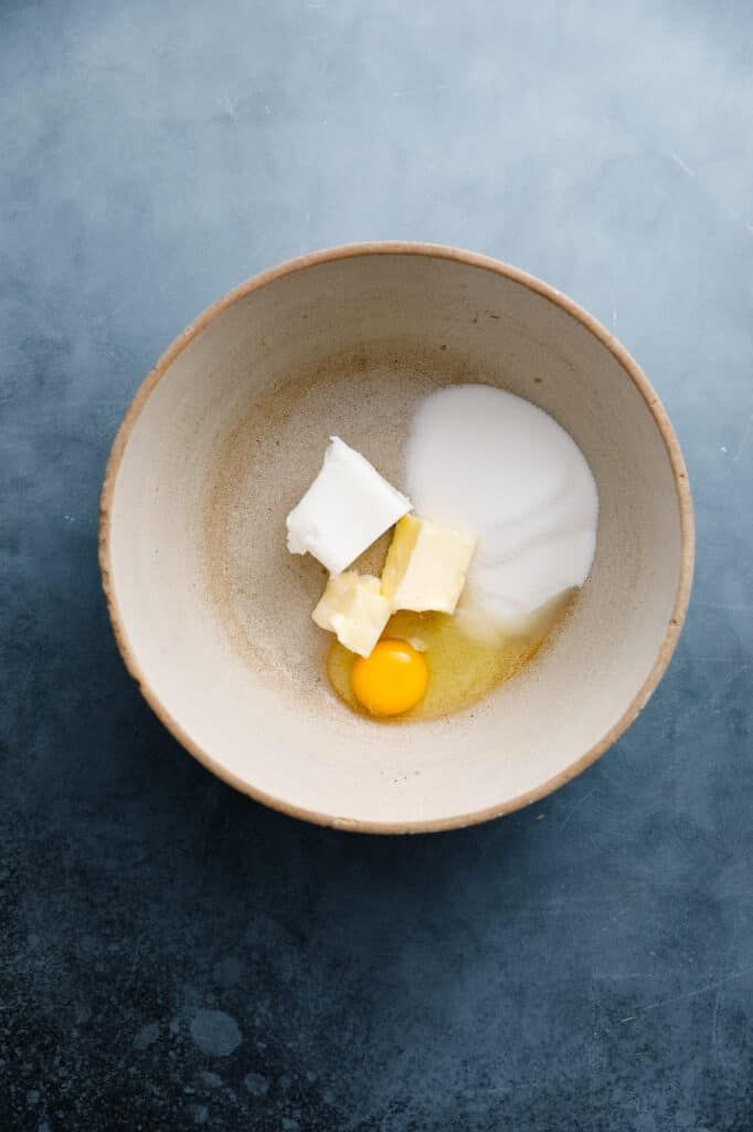 bowl with egg, butter, shortening and sugar ready to make snickerdoodle muffins
