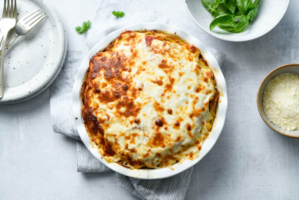 baked spaghetti pie straight from the oven with melty browned cheese on top