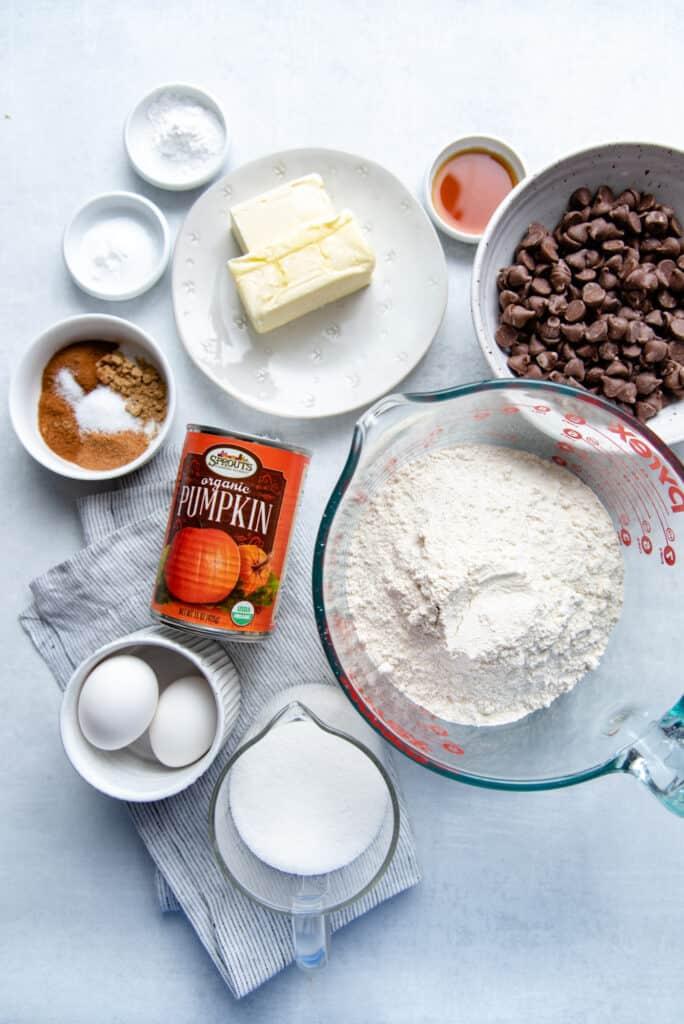 ingredients for pumpkin chocolate chip cookies with fresh pumpkin, flour, sugar, butter and vanilla