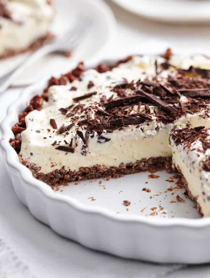 ice cream pie in a pie dish with a slice removed